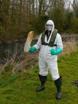Fly monitoring volunteer in protective equipment